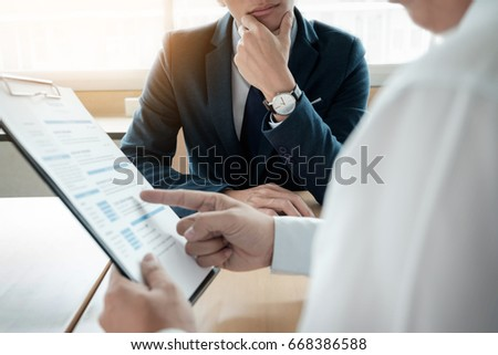 business man interviewer looking skeptical while listening to an asian female interview