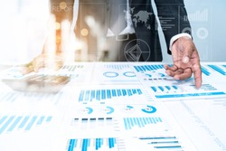 BUSINESS man Investment Advisory Partner TEAM Analyzes Company's Annual Financial Statements. Balance Sheets Work With Graph Papers.AUDIT TAX Analysis Concepts. BUSINESSMAN with Documents Statistical