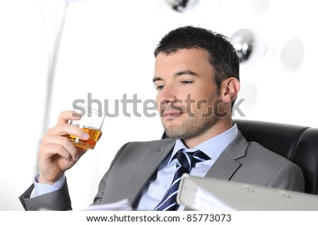 business man is drinking alchool at the office
