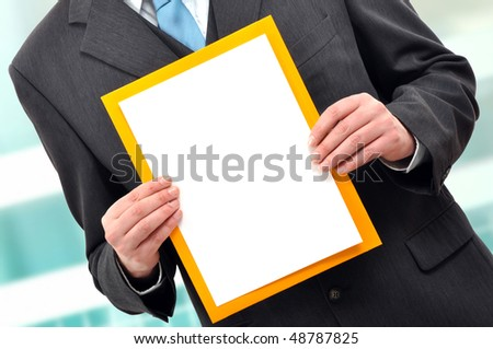 Business man is holding a piece of blank white paper, presentation background image.