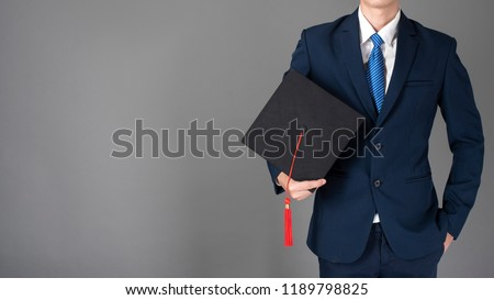 business man is holding graduation hat, business education concept