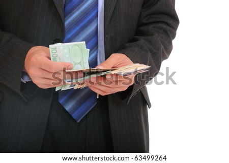 Business man is paying with euro banknotes