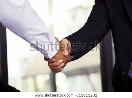 Business man is shaking hand together #611611202
