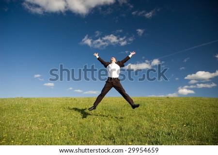 Business man jumping - stock photo