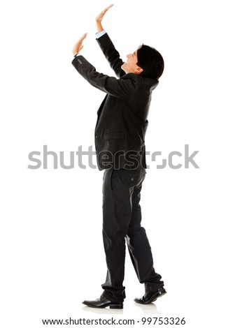 Business man lifting an imaginary object - isolated over a white background