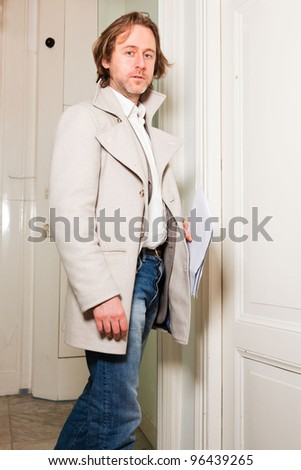 Business man long hair entering office