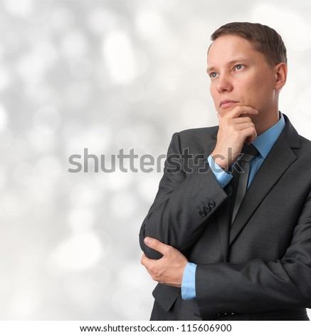 business man looking away and thinking. isolated on white background