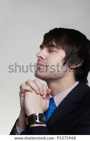 business man looking up almost id he's praying