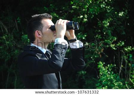 Business man looking with binocular
