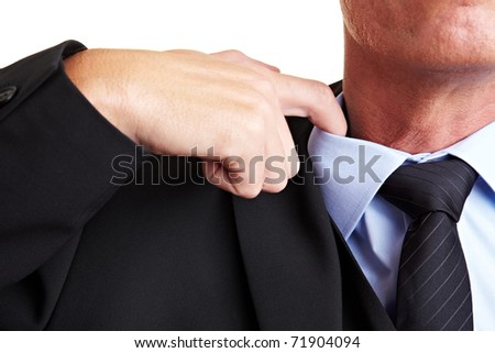 Business man loosens his shirt with his index finger