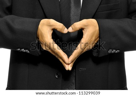 Business man make heart shape with his hand
