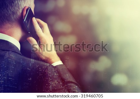 Business man making a phone call with smartphone.