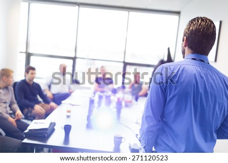 Business man making a presentation at office. Business executive delivering a presentation to his colleagues during meeting or in-house business training, explaining business plans to his employees. #271120523