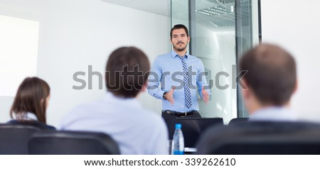 Business man making a presentation in office on job interview. Business presentation on corporate meeting. Recruiters evaluating the candidate.