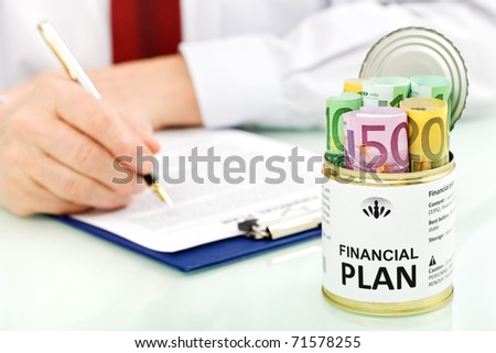 Business man making financial plans with an opened can of euro banknotes - closeup