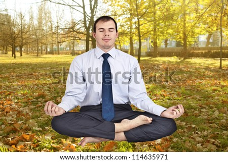 business man meditating in work shirt and tie.