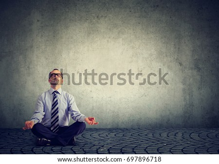 Business man meditating relaxing with eyes closed  #697896718