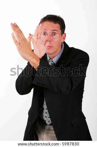 Business man mocking with his hand