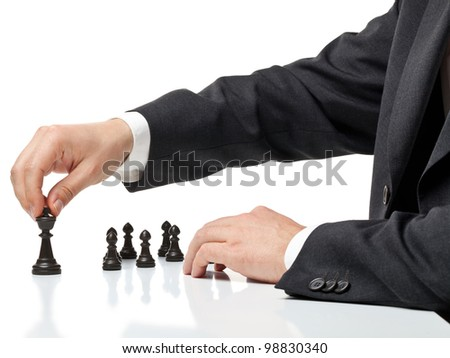 Business man moving chess figure with team behind - strategy or management concept