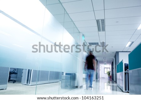 business  man moving in office corridor - stock photo