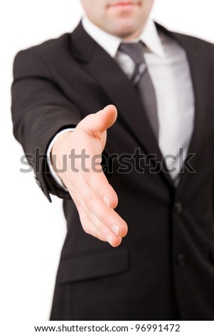 Business man offers his hand ready to seal a deal isolated on white