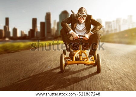 Business man on a pedal car
