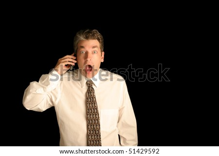Business man on Cell phone showing surprise