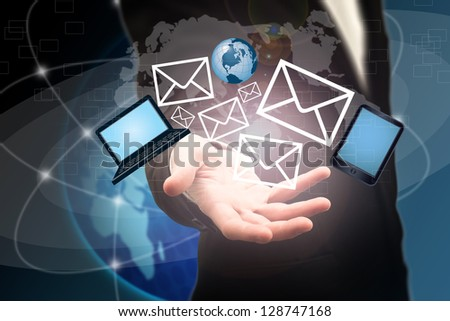 Business man opening mail in a futuristic touchscreen interface