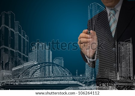 Business Man or Architect draw cityscape