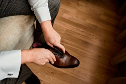 Business man or groom dressing up with classic elegant shoes.