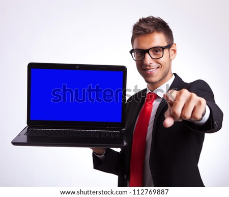 business man or student pointing at you to win a new laptop computer