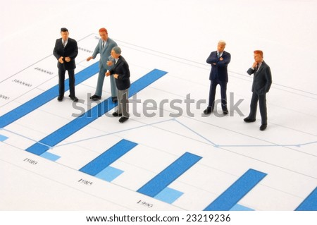 business man over economic chart in conversation