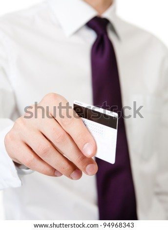 Business man paying by credit or debit card