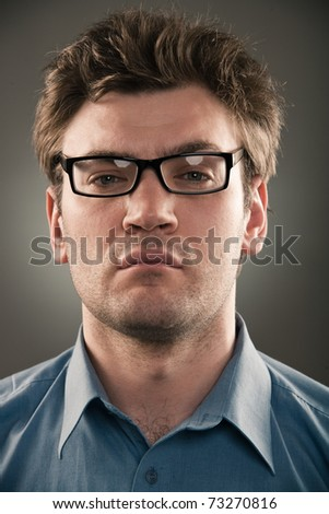 Business man person against gray background. One grunge fashion portrait  no hands of a long series images of face with different emotions.  studio light pattern