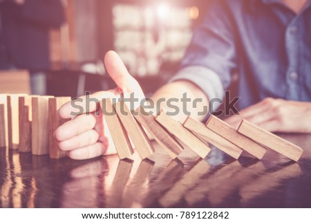 Business man placing wooden block on a tower concept risk control, Planning and strategy in business.Alternative risk concept,Risk To Make Buiness Growth Concept With Wooden Blocks