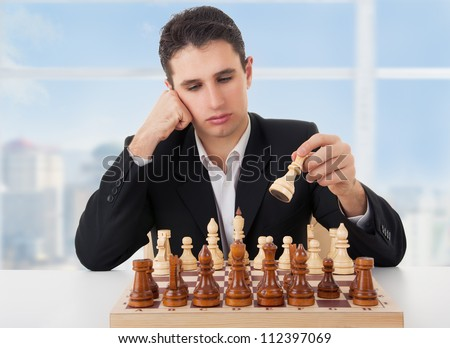 business man playing chess, making the first move