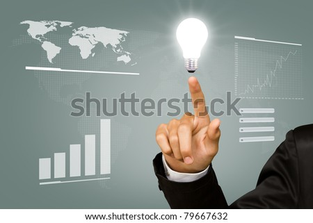 Business man point light bulb in his hand