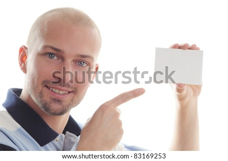 Business man pointing at a blank business card over white background