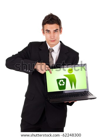 Business man pointing at a laptop with recycle icon isolated on white