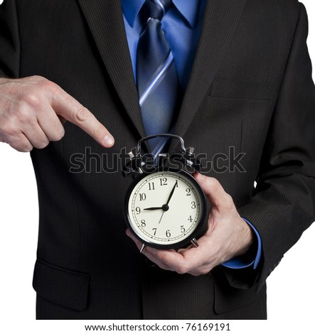 business man pointing at clock showing you are 5 minutes late