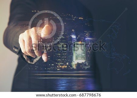 Business man pointing at growth graph and business concept. investment, business, future technology and money concept - closeup of man hand pointing at chart.