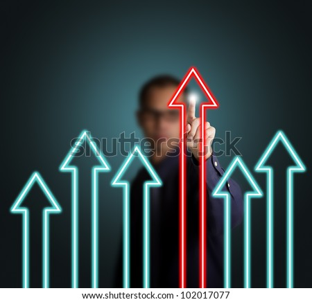 business man pointing at leading upward arrow, victory concept