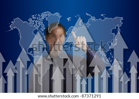 business man pointing at rising arrow with world map background