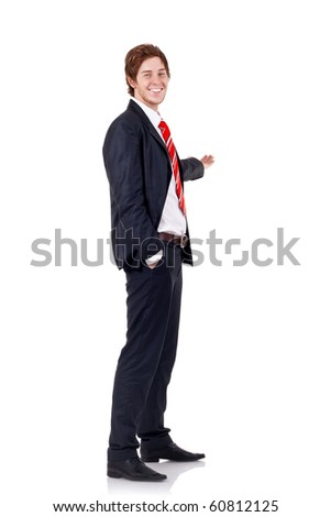 business man pointing at something as if he was presenting - isolated over a white background
