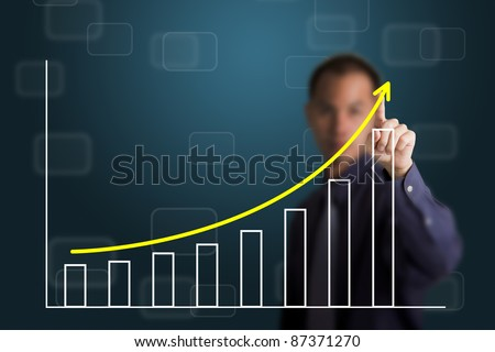 business man pointing at upward trend graph