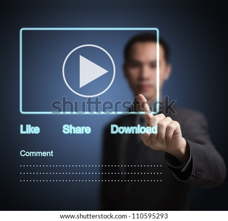 business man pointing at video clip on  social network touchscreen