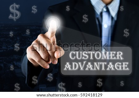 Business man pointing hand on transparent screen with Money symbol and text written Customer Advantage