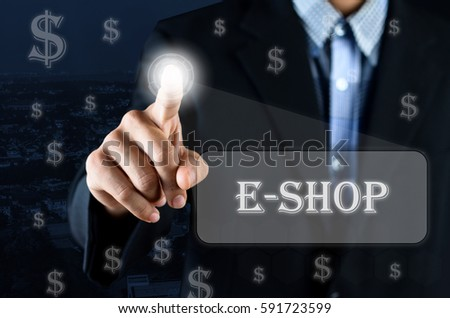 Business man pointing hand on transparent screen with Money symbol and text written E-Shop