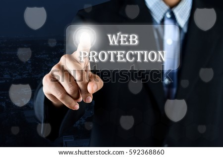 Business man pointing hand on transparent screen with Security symbol and text written Web Protection