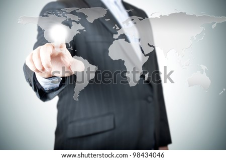 Business man pointing on the touch screen with world map. Concept for connectivity - stock photo
